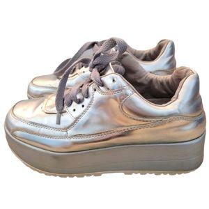 Metallic silver platform sneakers.